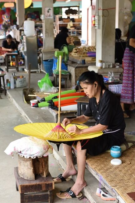 Woman working at the Umbrella Making Centre