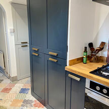 Mediterranean cabinets and tiles in kitchen fit by kitchens insynk ltd