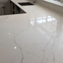 Alabaster quartz being fitted Miss granite worktops / kitchens insynk solihull