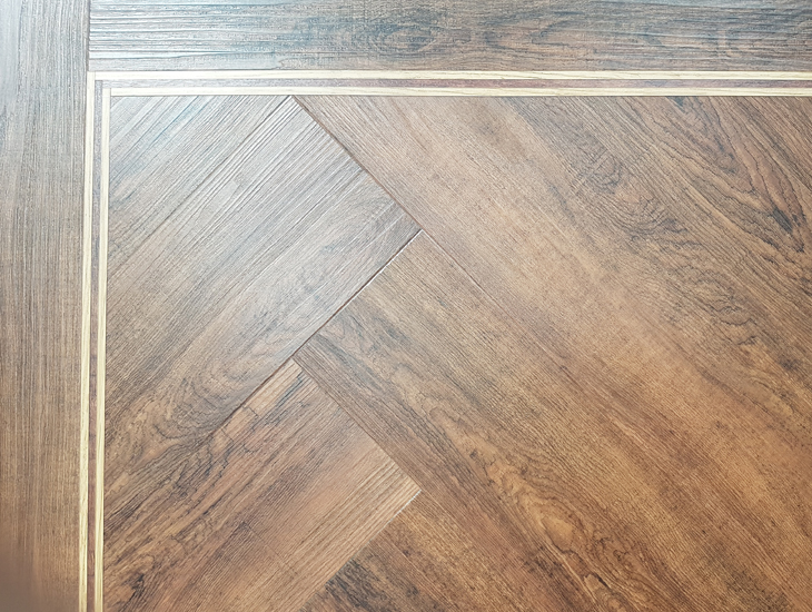 Herringbone American Walnut ambiance flooring - 115 x 457mm