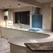 Quartz Worktops with Solid Wood Breakfast Bar