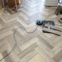 laying herringbone Ambiant luxury vinyl flooring at kitchens insynk ltd