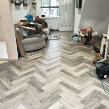progress with laying random grey herringbone Ambiance luxury vinyl flooring