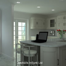 Alabaster units in shaker style and carrera quartz worktops designed by kitchens insynk ltd solihull
