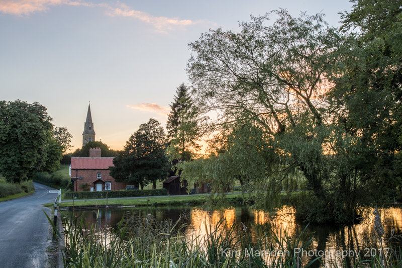 Warter pond & church at sunset