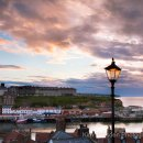 Sunset over Whitby harbour with lampost