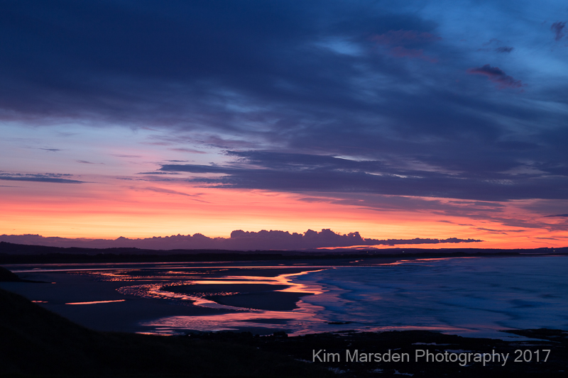 Budle Bay estuary sunset looking towards Lindisfarne