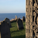 Caedmon's Cross, St Mary's Church, overlooking graveyard & lighthouse - Whitby