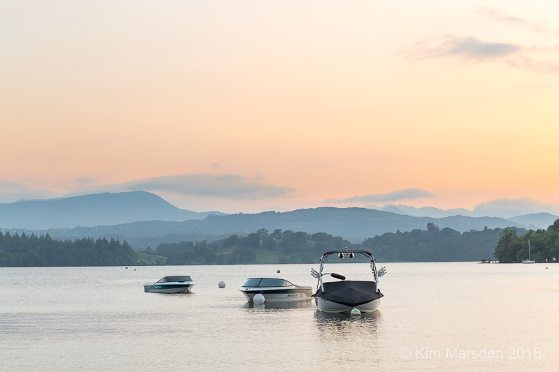 Boats on Windermere in sunset light