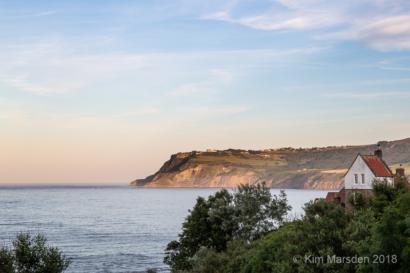 Ravenscar in late evening light from Robin Hoods Bay