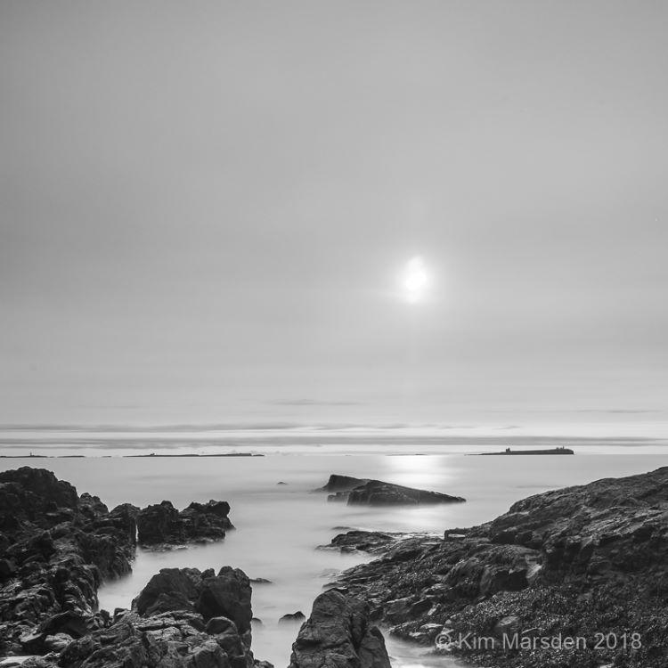 Rising sun over the Farne Islands (Mono)