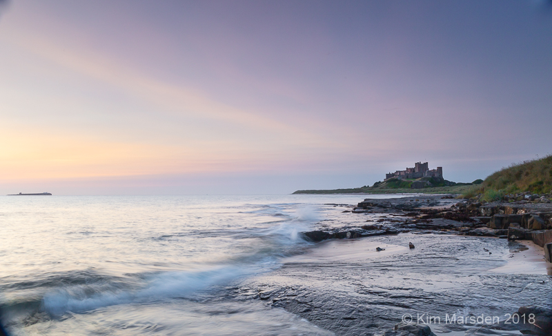 Bamburgh Castle in early dawn light