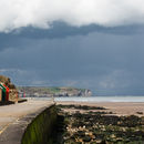 Colourful beach huts & moody skies