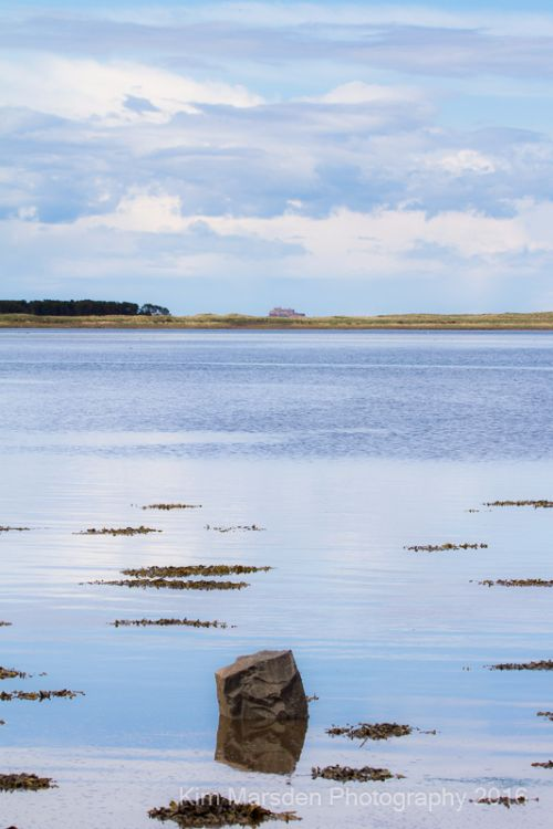 Calm waters in Budle Bay looking towards Lindisfarne
