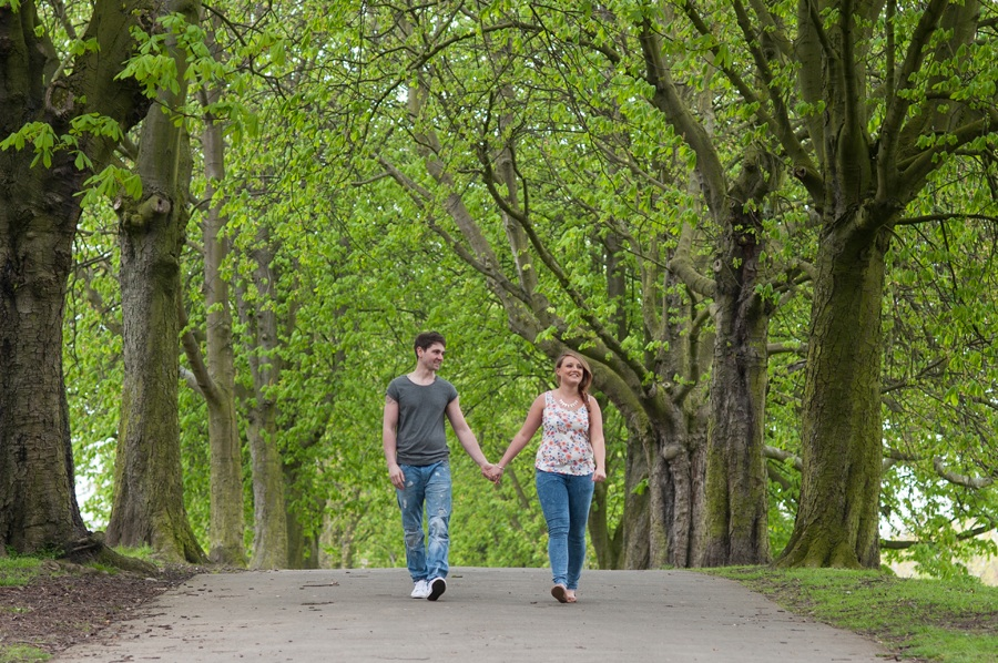 Engaged_couple_walk_along_path_at_Thornes_park
