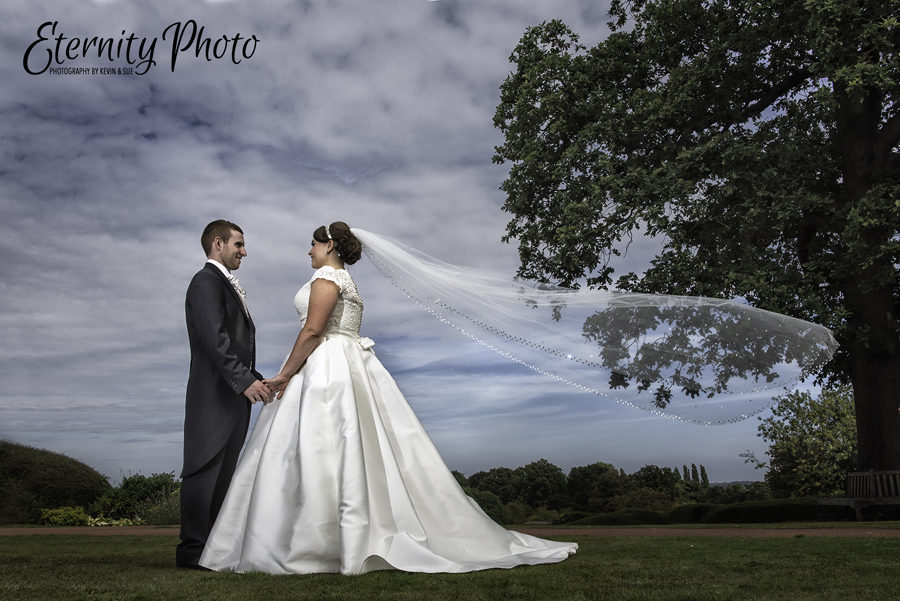 Oulton Hall wedding photography by Eternity Photo Ltd.  Bride and groom + veil swish.