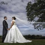 Oulton Hall wedding photography by Eternity Photo Ltd.  Bride and groom + veil swish.