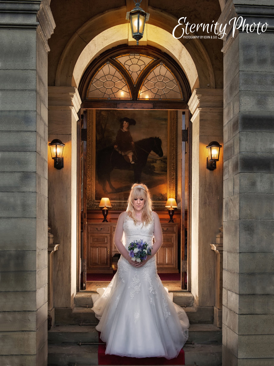Bagden Hall Hotel wedding photography by Eternity Photo.  Bridal portrait in doorway.