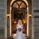Bagden Hall Hotel wedding photography by Eternity Photo.  Bridal portrait in doorway.