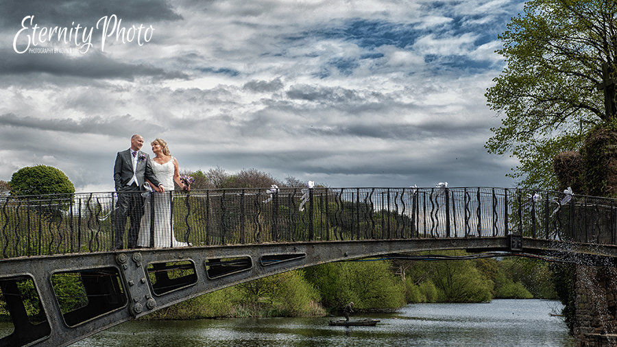 Bride and groom on the bridge at Waterton Park Hotel on their wedding day.