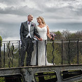 Waterton Park Hotel wedding photography by Eternity Photo. Bride and groom on the bridge.