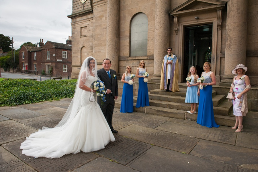 Horbury wedding photographer. The bride arriving with her father at St Peters church, Horbury, West Yorkshire.