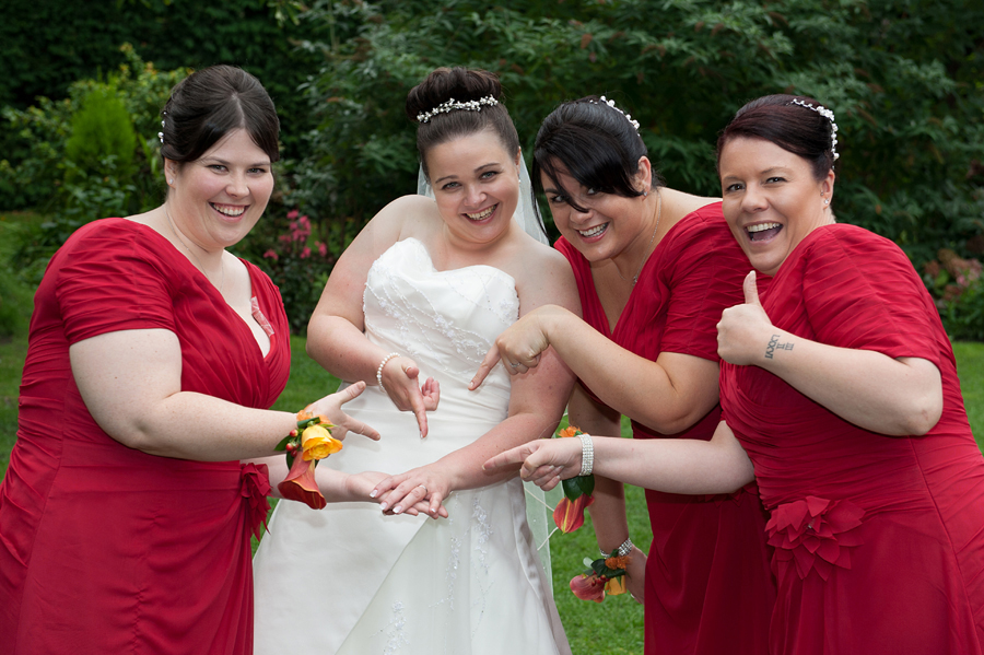 Dimple Well Lodge Hotel, Ossett wedding photography. The bride showing of her ring to her bridesmaids.