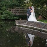 Bride_and_groom_look_down_at_the_lake_at_Monk_Fryston_Hotel