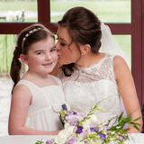 Wakefield wedding photography by Eternity Photo.  The couple's two children join in after the signing of the register.