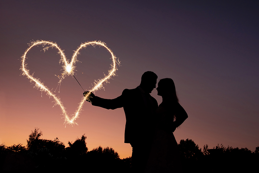 Wedding silhouette and sparkler photo by West Yorkshire photographer