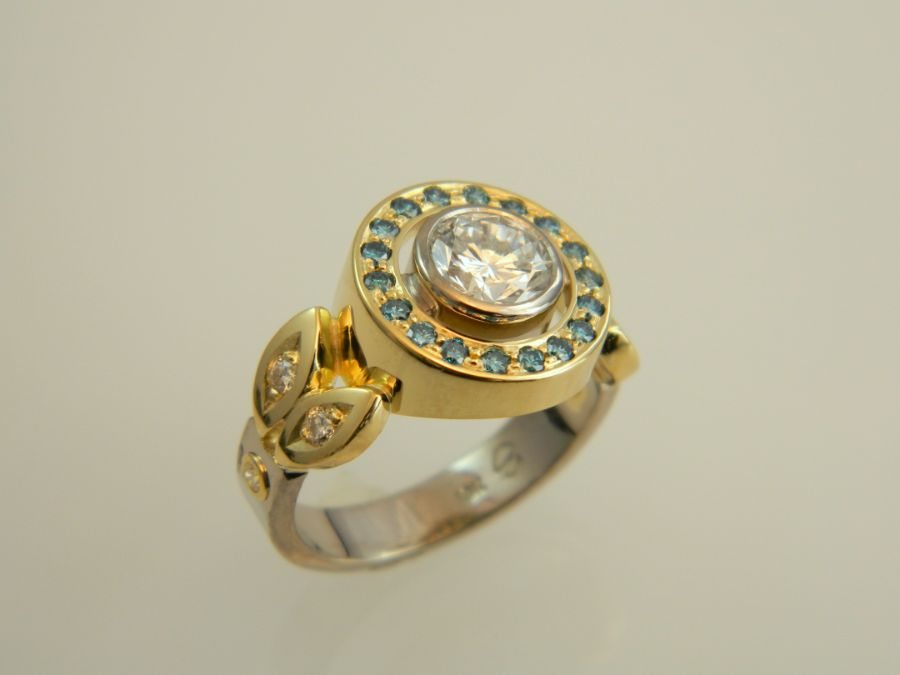 Gold Ring with white & blue Diamonds