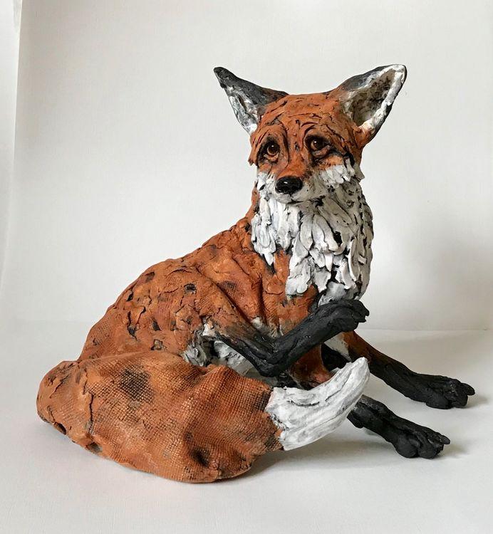 Scratching fox