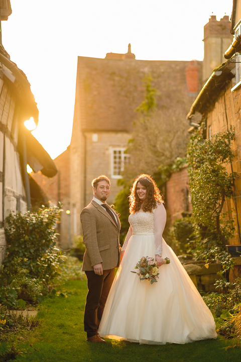 Evesham wedding photography. Livi & Adam got married and had their reception at the beautiful countryside inn, the Fleece Inn at Bretforton. The location was idyllic and the weather fair, if a little cold! The best part of the day turned out to be sunset when this beautiful golden light flooded the grassy alley between the Inn and the next property. Fleece Inn wedding photography by Lee Webb