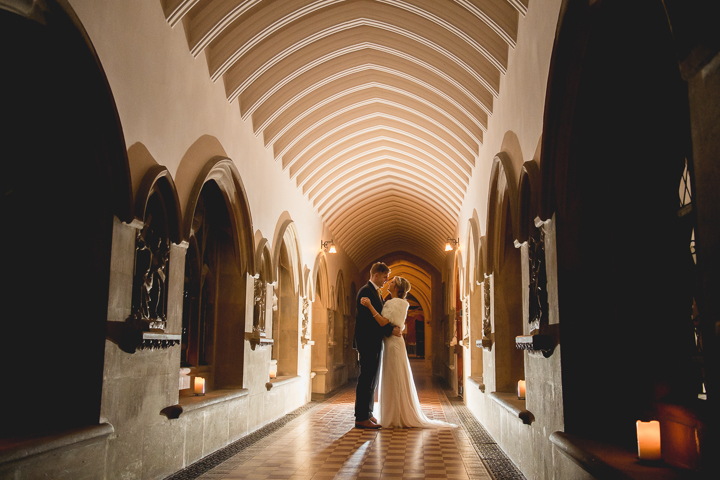 Stanbrook Abbey Wedding Photography. The bride and groom stand in the cloisters of Stanbrook Abbey in Worcestershire.