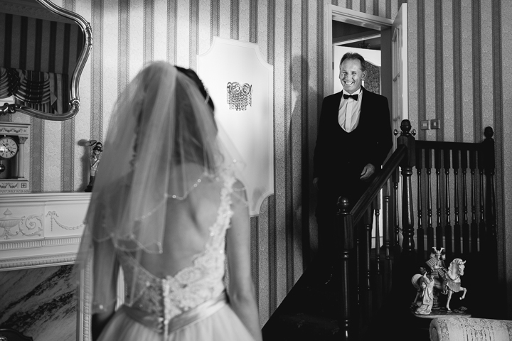This black and white wedding photo shows the father of the bride seeing his daughter for the first time on the morning of her wedding day. The wedding was held at the amazing Stanbrook Abbey in Worcestershire.