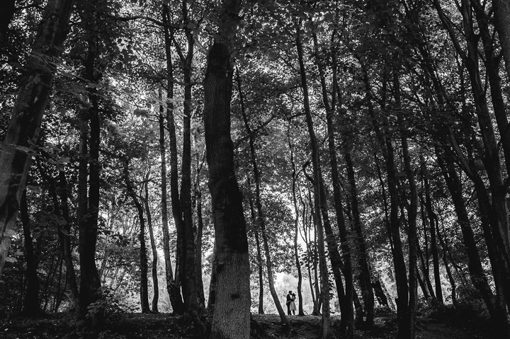 Worcestershire wedding photography. A bride and groom embrace in woodland in this stunning black and white image