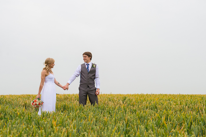 Mythe Barn wedding photography. This wedding photo was taken at Mythe Barn in Leicestershire on a rainy day, although you'd be hard pressed to tell! The bride and groom were happy to stand outside despite the conditions and I'm so glad they did - they have a wonderful set of wedding photos to look through!