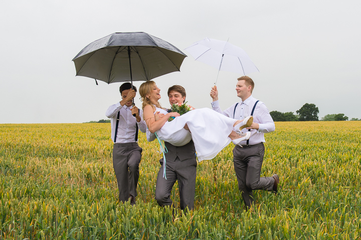 Mythe Barn wedding photography. This is one side to wedding photography that you rarely get to see - In the previous wedding photo we saw the bride and groom happily standing in a wheat field - what you didn't see was how they got there! This wedding photo was taken at Mythe Barn in Leicestershire.