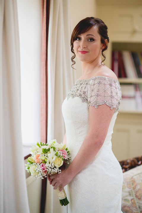 Birtsmorton Court wedding photography. A bride poses for a portrait before her wedding at Birtsmorton Court