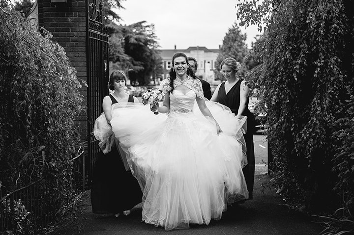 Worcestershire wedding photography. A bridal party arrives at St George's church in Worcester, Worcestershire