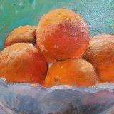 'Oranges on bowl'