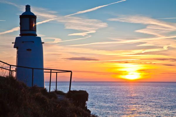Polperro lighthouse and sunrise
