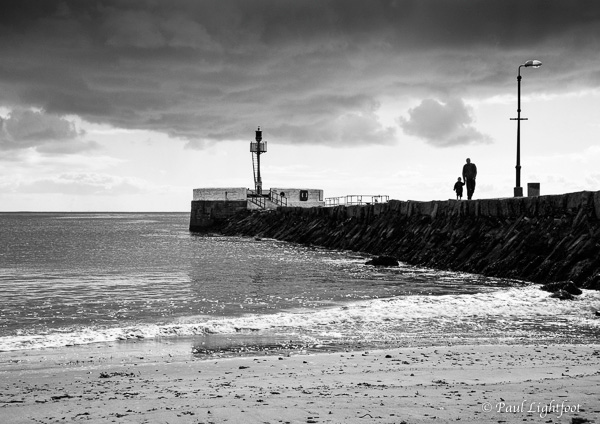 Father and son on the Banjo pier, Looe