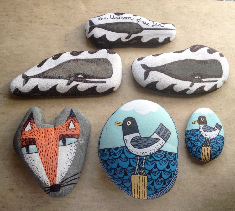 Group of illustrated Stone. Painted, drawn and ready to fly.