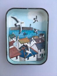 Cornish Rooftops 3-D artwork in a vintage tobacco tin