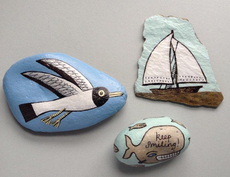Trio of coastal themed stones.