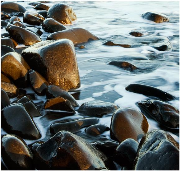 Rocks and swirling sea
