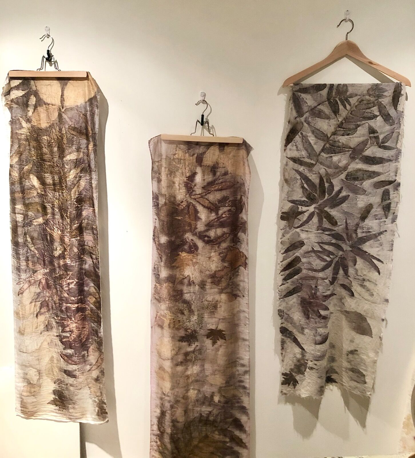 Botanical contact print on silk and calico using the 'bundle and steam' method for natural dye extraction
