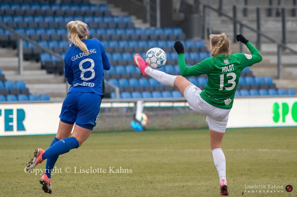 "Olivia Moller Holdt (#13 Fortuna Hjorring) and Laura Guldbjerg Pedersen (#8 HB Køge) battle for the ball in the ""Gjensidige Kvindeliga"" match between Fortuna Hjorring and HB Koge at Hjorring stadium in Hjorring, Denmark"