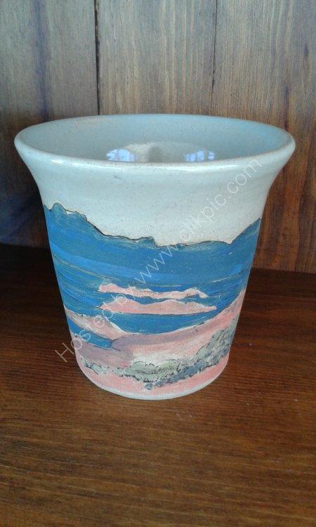 Stoneware wheel thrown vase with underglaze painting of landscape and celadon glaze